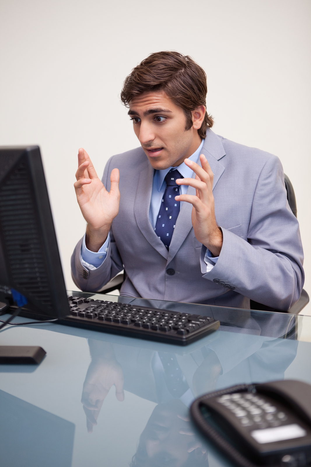 bigstock-Young-businessman-getting-surp-27297122