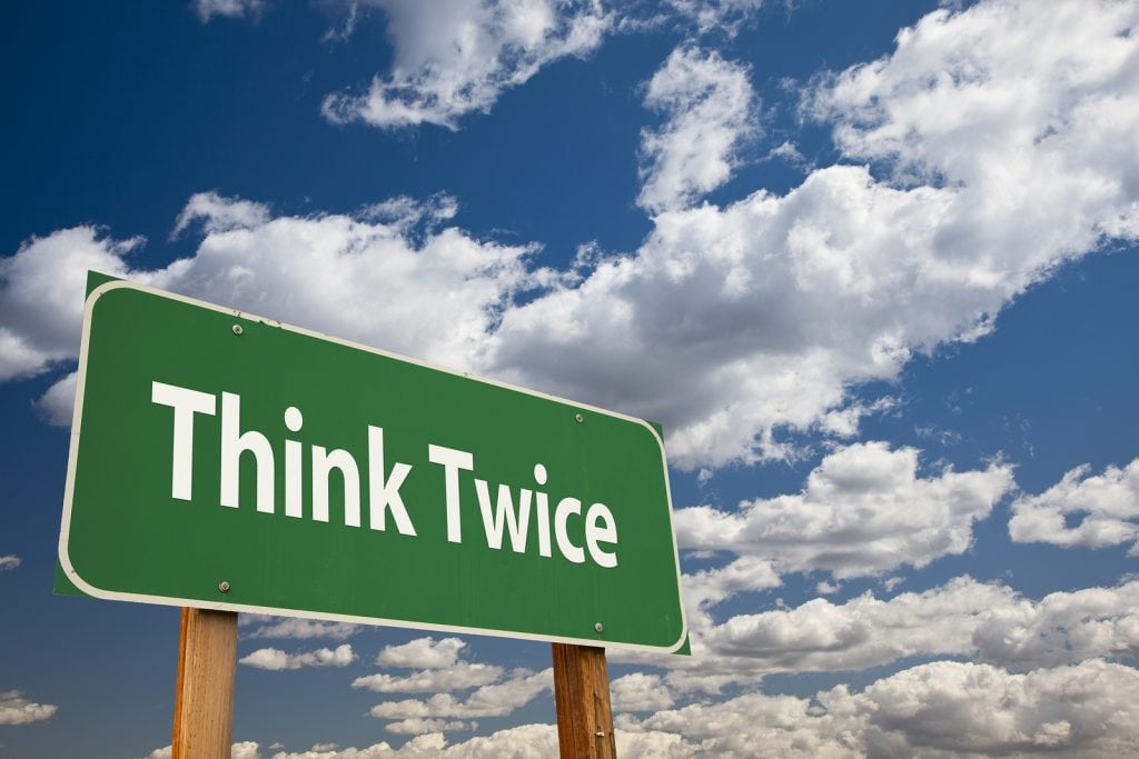 Think-Twice-Green-Road-Sign-Ov-41629561