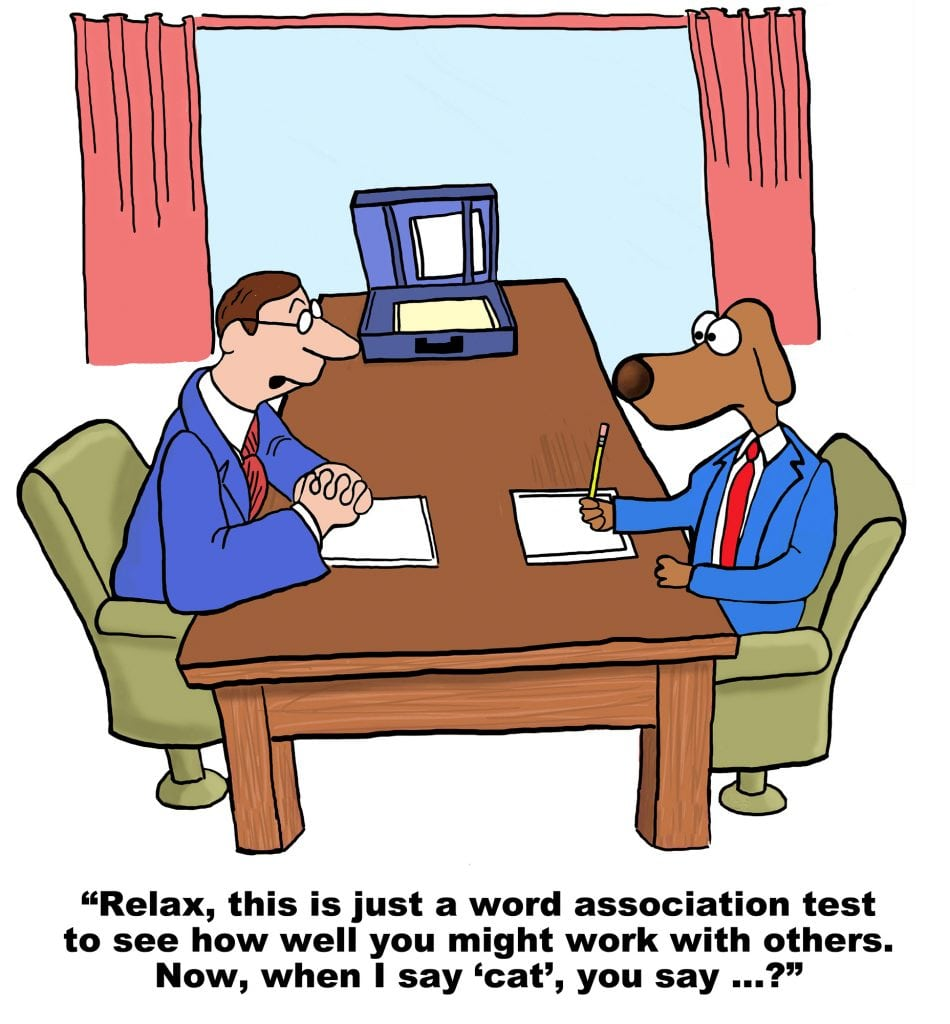 Cartoon of businessman dog interviewing for a new job.  As part of the recruiting process he has to take a personality test.  The first word association is cat....