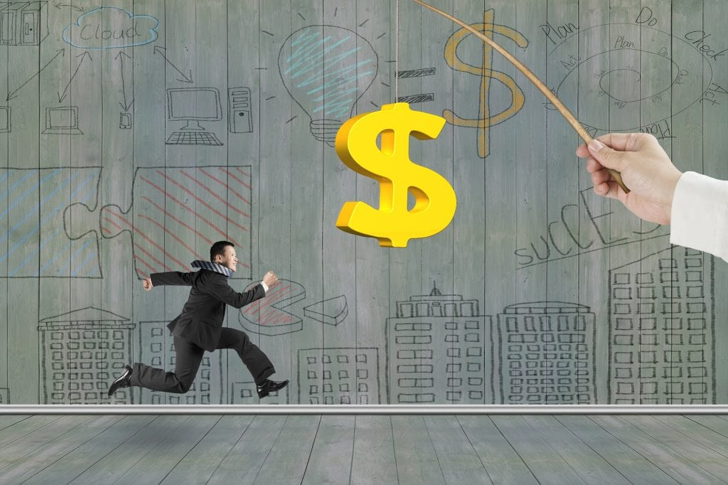 Man running after 3D golden dollar sign bait on fishing rod hand holding with business concept doodles wood wall background